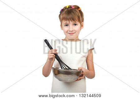 small child whisk whisk something in a pot