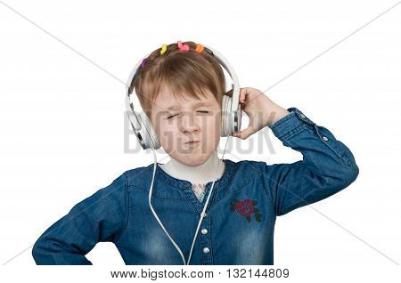 Little girl listening to music loudly on headphones