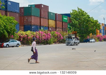 Yangon Myanmar - April 25 2016 : Burmese man walking in front of container terminal in Yangon
