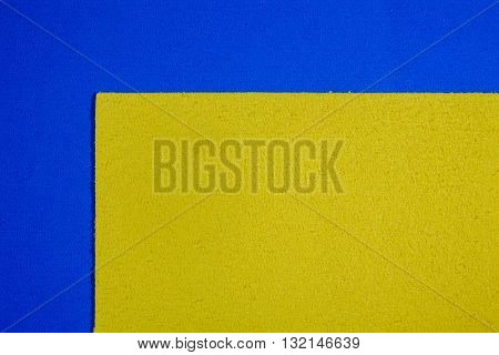 Eva foam ethylene vinyl acetate lemon yellow surface on blue sponge plush background