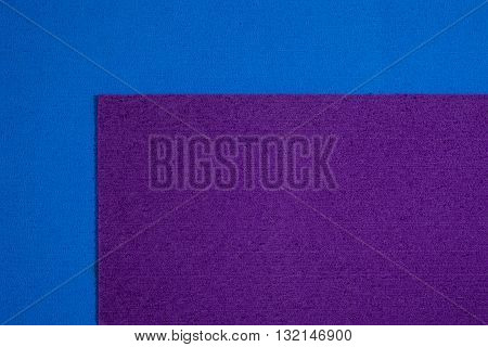 Eva foam ethylene vinyl acetate purple surface on blue sponge plush background