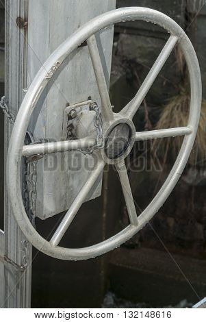 Chain around boat's wheel serves as security