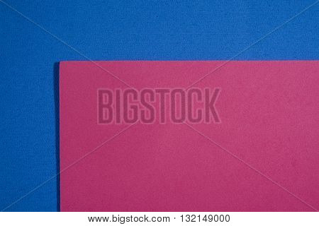 Eva foam ethylene vinyl acetate smooth pink surface on blue sponge plush background