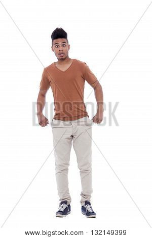 Young and careless afro man with empty pockets. Isolated image on white background.