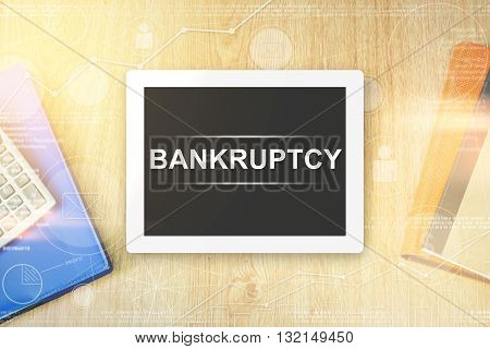 bankruptcy word on tablet with soft light vintage effect
