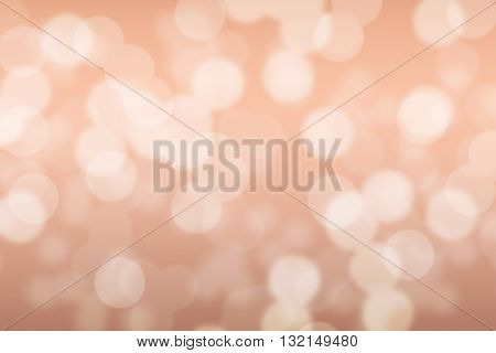 Abstract circular peach color light bokeh background