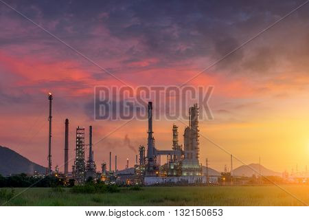 Twilight of oil refinery plant with sunshine Morning scene.