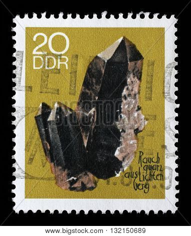 ZAGREB, CROATIA - SEPTEMBER 06: A stamp printed in GDR shows Smoky Quartz from the series Minerals, circa 1969, on September 06, 2014, Zagreb, Croatia