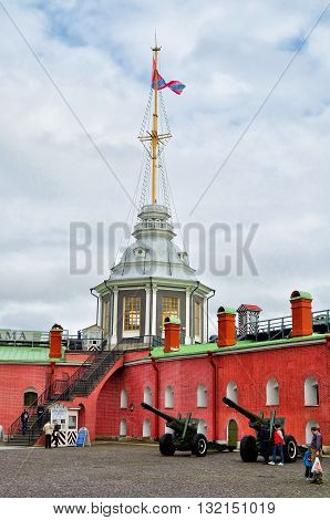 SAINT PETERSBURG RUSSIA - MAY 27 2016. Flag Tower with Russian Navy flag and Naryshkin Bastion on the territory of Peter and Paul Fortress St Petersburg Russia