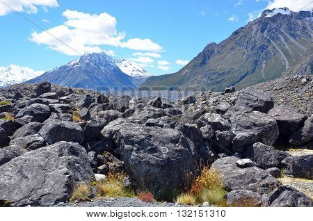 Scree slope at the base of a snow covered rocky mountain range