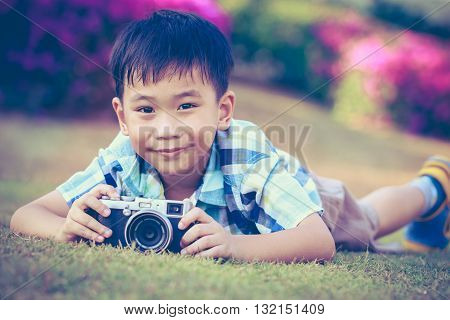 Boy Taking Photo By Camera, Exploring Nature At Park. Active Lifestyle, Curiosity, Pursuing A Hobby