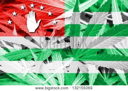 Flag of Abkhazia on cannabis background. Drug policy. Legalization of marijuana