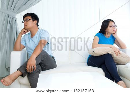 Asian young Couple having argument in the living room