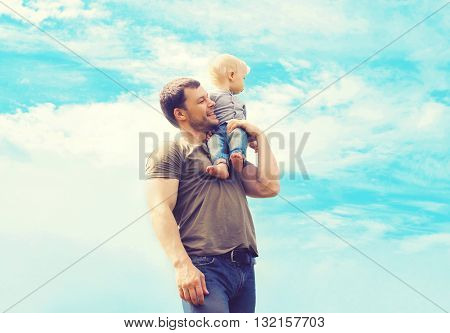 Lifestyle Atmospheric Photo Happy Father And Son Child Outdoors Over Blue Sky With Clouds