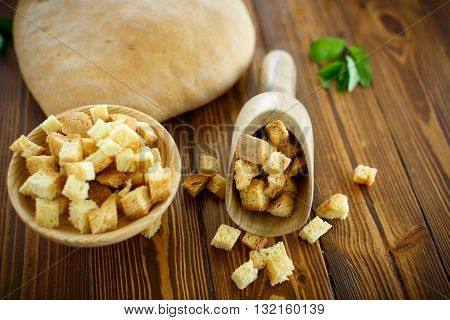 fried croutons of homemade bread on a wooden table