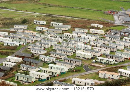 Rhossili Wales UK - October 22 2015 :High view from a hillside looking down onto a mobile home site near the sea.