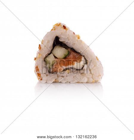 A delicious sushi roll dipped in sauce on a background.