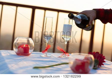 Romantic dinner on the roof at sunset