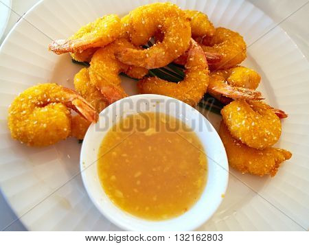 Yummy deep fried shrimp platter served with sauce
