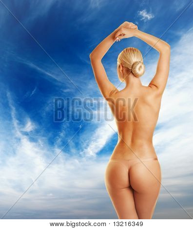 Beautiful young woman behind blue sky
