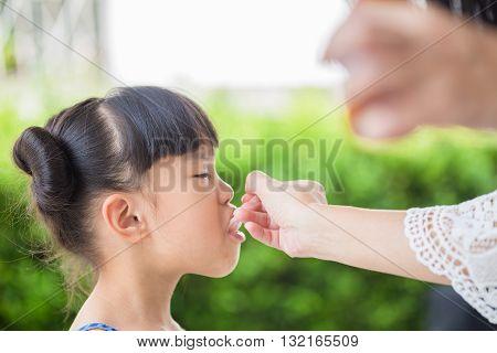 little girl is feeling better from taking medicine
