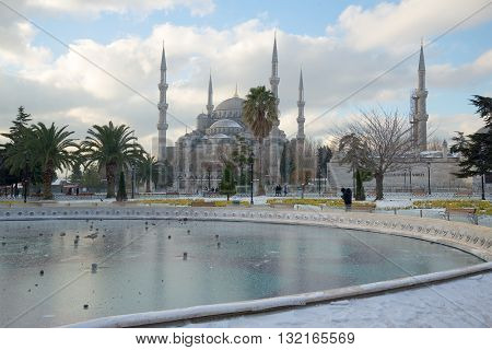 ISTANBUL, TURKEY - JANUARY 09, 2015: Frozen fountain and the Blue Mosque a frosty january day. Historical landmark of the city Istanbul, Turkey