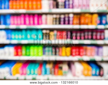 Blurred Colorful Supermarket Products On Shelves