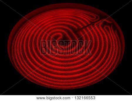 Glowing red hot heating elements on a ceramic stove.