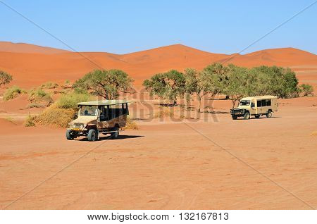 SOSSUSVLEI NAMIBIA - JAN 29 2016: Safari cars in the Namib-Naukluft National Park. The most visited place in Namibia