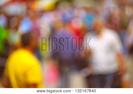 Street crowd out of focus unrecognizable everyday ordinary men and women as blur urban background.