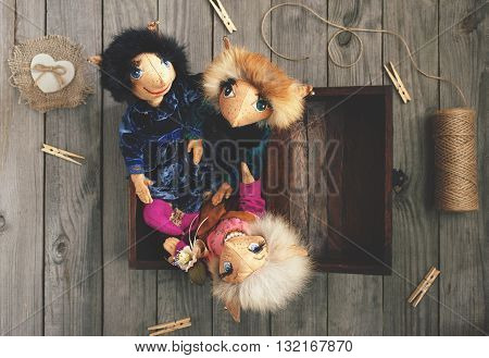 Collection vintage toy handmade fantastic character elves in a wooden chest on the wooden table top view