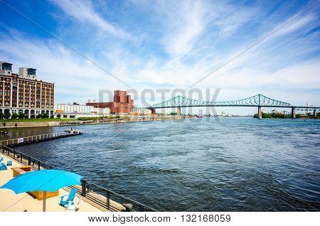Blue sky over Montreal old port beach on Saint Laurent river facing Jack Cartier bridge