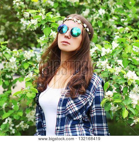 Fashion Portrait Of Hippie Woman In A Flowering Garden