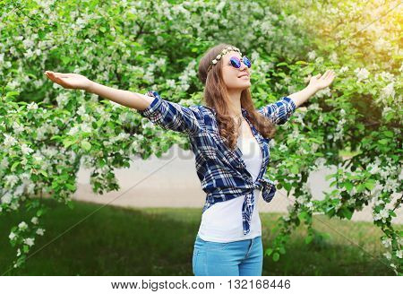 Happy Pretty Hippie Woman Enjoying Smell In Flowering Spring Gar
