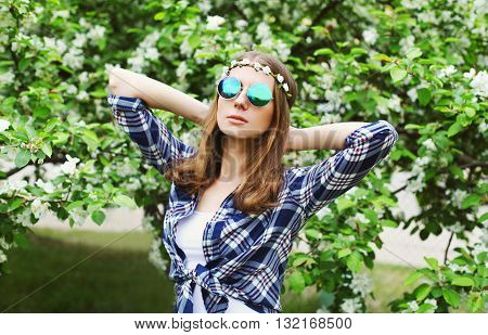 Portrait Fashion Hippie Woman In Spring Flowering Garden