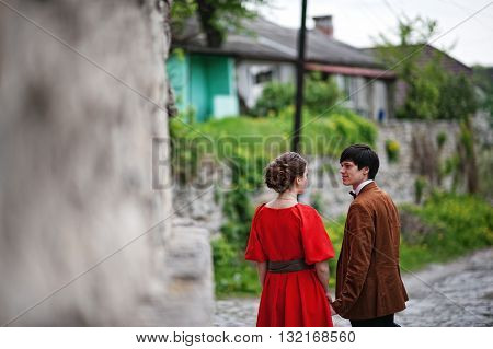 Couple  In Love. Stylish Man At Velvet Jacket And Girl In Red Dress In Love Together