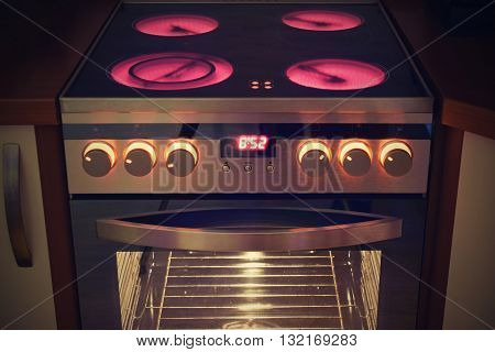 Electric ceramic stove inside the kitchen. Home cooking - appliances.