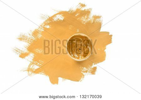 Jar of yellow paint on yellow painting isolated over white