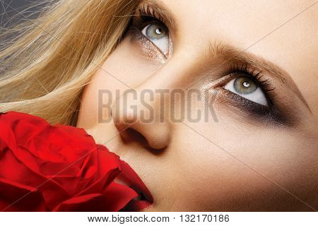 very beautiful blonde woman with well-groomed skin feminine look and perfect makeup
