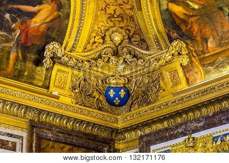VERSAILLES, FRANCE - MAY 12, 2013: This is fragment of ceiling decoration of one of the halls of the world's famous Palace of Versailles.