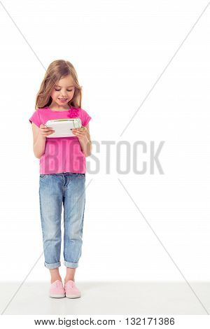 Cute Little Girl With Gadget