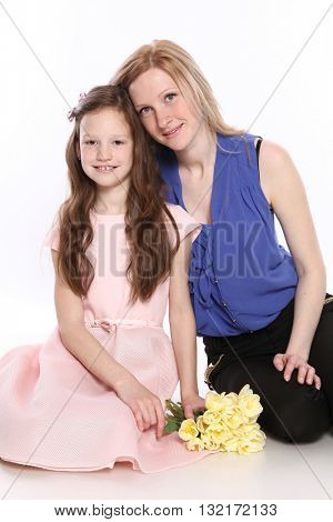 young mother with daughter isolated on white