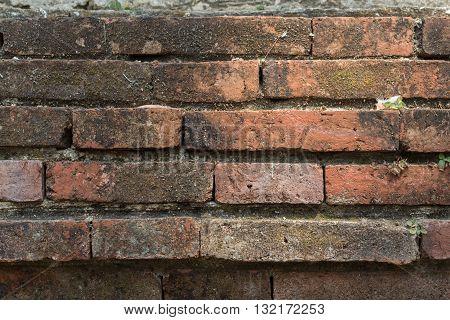 Acient brick wall. Grunge brick wall background. Background of old vintage brick wall. Grunge and dirty wall texture.