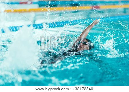 back stroke swimmer in the pool, horizontal image,