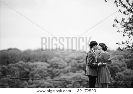 Couple Kissing In Love Background Fantastic Nature And Landscape. Stylish Man At Velvet Jacket And G