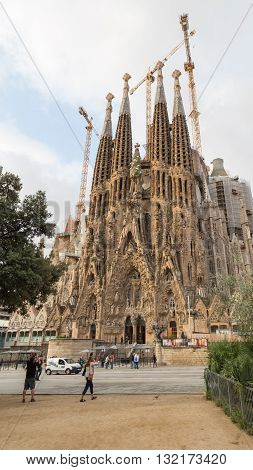 Barcelona - 9 October 2015: View of the towers of the church of the Sagrada Familia in good weather and the people around October 9 2015 Barcelona Spain