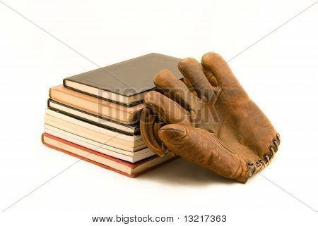 Stack Of Book And Old Baseball Mitt