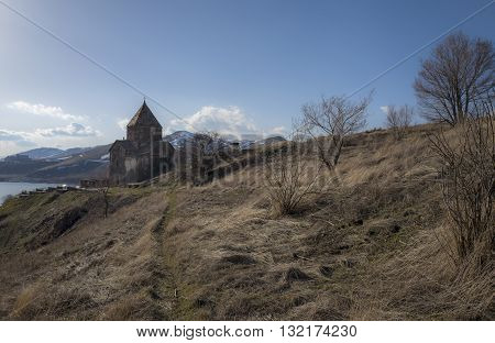 View on Sevanavank Monastery near of Sevan Lake and snowy mountains