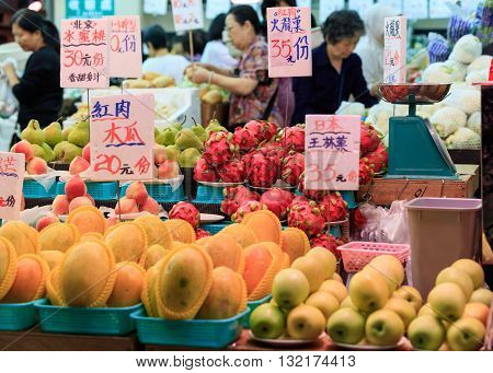 Hong Kong, Special Administrative Region of the People's Republic of China - 19 April 2016: traditional asian market stall full of fresh fruits