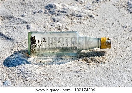 Message In A Bottle Abandoned On Sandy Beach
